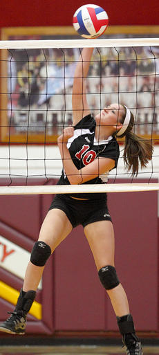 "<div class=""source"">Donald Richie</div><div class=""image-desc"">Junior Samantha Adkins jams the ball back into Powell County territory Monday during varsity volleyball play.</div><div class=""buy-pic""></div>"