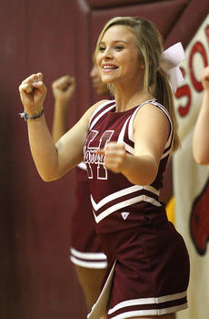 "<div class=""source"">Donald Richie</div><div class=""image-desc"">Shelby Lesak cheers for the Fillies Saturday night at Harrison County High School.</div><div class=""buy-pic""></div>"