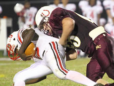 "<div class=""source"">Donald Richie</div><div class=""image-desc"">Spencer Covington takes down Holmes quarterback Dominick Cheek last Friday in the Thorobreds homecoming game against the Bulldogs.</div><div class=""buy-pic""></div>"