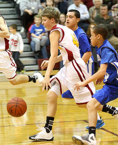 """<div class=""""source"""">Donald Richie</div><div class=""""image-desc"""">Thomas Thompson drives to the basket Monday night at Harrison County Middle School.</div><div class=""""buy-pic""""></div>"""