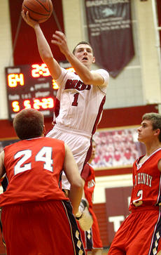 "<div class=""source"">Donald Richie</div><div class=""image-desc"">Senior Tommy Vallandingham drives past two St. Henry defenders for the basket last Friday in the Breds home opener on the Hilltop.</div><div class=""buy-pic""></div>"