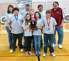 """<div class=""""source""""></div><div class=""""image-desc"""">At regionals, front row, from left, Devon Ayala - first place male elementary division, Amber Kearn - fourth place female elementary division, Ava Craig - third place female elementary division, Kennedy Sumpter - second place female elementary division; Marshall Canupp, center; back row, coaches Melissa Shepard, Dwight Lainhart, Larry Feeback and Tim Shepard.</div><div class=""""buy-pic""""></div>"""