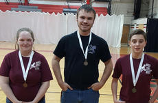 """<div class=""""source""""></div><div class=""""image-desc"""">Individuals archery winners in the KHSAA Region 7 were: from left, Kristin Feeback, fourth place score of 280, Trent Evans, third place score of 282, Kennedy Sumpter, first place score of 289.</div><div class=""""buy-pic""""></div>"""