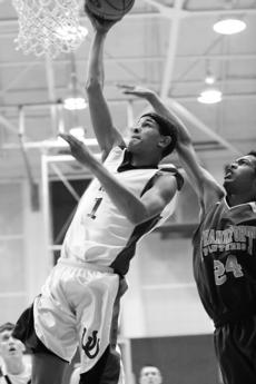 """<div class=""""source""""></div><div class=""""image-desc"""">Junior Malcolm Thomas attempts to elude the reach of a Frankfort High player Tuesday in the Breds' 61-42 homecoming win over the Panthers. Thomas assisted with 18 points and 10 rebounds, while Eric Case contributed 17 points.</div><div class=""""buy-pic""""><a href=""""http://web2.lcni5.com/cgi-bin/c2newbuyphoto.cgi?pub=081&orig=s_malcolm.thomas_2457.jpg"""" target=""""_new"""">Buy this photo</a></div>"""