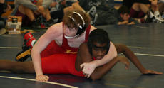 """<div class=""""source"""">Mary Charles Coy</div><div class=""""image-desc"""">Harrison County's Sean Mullikin works his moves to beat his opponent from Scott County this past weekend at the annual Danville Duals.</div><div class=""""buy-pic""""></div>"""