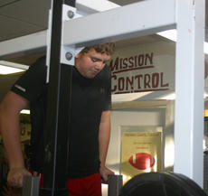 """<div class=""""source"""">Mike Aldridge</div><div class=""""image-desc"""">8th Grader Hayden Switzer works out on the Dip machine in the first day of workouts for the middle school football players after the Christmas break. More than thirty players that will be high school students next season are working out in the weight room in the off season.</div><div class=""""buy-pic""""><a href=""""http://web2.lcni5.com/cgi-bin/c2newbuyphoto.cgi?pub=081&orig=s_weightroom_3262.jpg"""" target=""""_new"""">Buy this photo</a></div>"""
