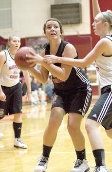 "<div class=""source"">Donald Richie</div><div class=""image-desc"">Hayley Perkins drives against the defense last Friday as the HCHS Fillies held an inter-squad scrimmage during ""Meet the Breds and Fillies"" festivities.</div><div class=""buy-pic""></div>"