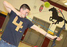"""<div class=""""source"""">Becky Barnes</div><div class=""""image-desc"""">Harrison County archer Josh Waits lines up with his teammates on Monday for practice. The Harrison County students will be competing in the state tournament on March 19 in Louisville. The next level will be nationals in May, which will also be in Louisville.</div><div class=""""buy-pic""""><a href=""""/photo_select/22296"""">Buy this photo</a></div>"""