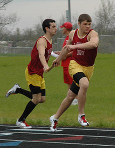 """<div class=""""source"""">Danny Simpson</div><div class=""""image-desc"""">Joe Thomas, left, hands off to Nick Slucher in the 3200M Relay in last Thursdays Montgomery County Invitational. They won their meet.</div><div class=""""buy-pic""""></div>"""