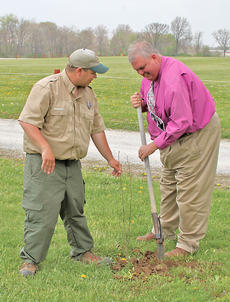 "<div class=""source"">Josh Shepherd</div><div class=""image-desc"">ARBOR DAY IS FRIDAY — To commemorate Arbor Day this Friday, Michael Carter of the Kentucky Division of Forestry brought an eastern Red Bud sapling to be planted at Flat Run Veteran's Park. Assisting with the commemoration is Harrison County Judge Executive Alex Barnett.</div><div class=""buy-pic""><a href=""/photo_select/27190"">Buy this photo</a></div>"
