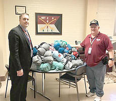 """<div class=""""source""""></div><div class=""""image-desc"""">Patrick Sinclair [chief of volunteer service] receiving a donation of 200 blankets from Brian Kinney [V.A. Volunteer and representive for Cynthiana Elks Lodge and Lady Elks] at the Leestown V.A. location to give to veteran patients and homeless veterans at both Cooper and Leestown facilities. Photo by Brian Kinney</div><div class=""""buy-pic""""></div>"""