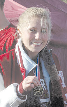 """<div class=""""source"""">Danny Simpson</div><div class=""""image-desc"""">Senior Chelsee Mattox was 44th in her race in the oldest class to claim her medal</div><div class=""""buy-pic""""></div>"""