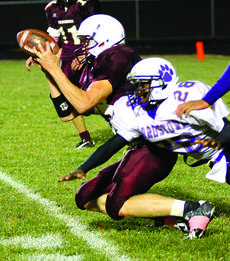 "<div class=""source"">courtesy of Donald Richie/Richie's Photography</div><div class=""image-desc"">Brandon Barnett gets his hands on the ball just inside the goal line Saturday night, but the points weren't awarded because Barnett was knocked back across the line during the play.</div><div class=""buy-pic""><a href=""/photo_select/6424"">Buy this photo</a></div>"