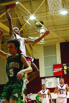 """<div class=""""source"""">courtesy of Donald Richie/Richie's Photography</div><div class=""""image-desc"""">Malcolm Thomas gets away from St. Pat last Saturday, gaining one of his three dunks in the first half of play.</div><div class=""""buy-pic""""><a href=""""/photo_select/11585"""">Buy this photo</a></div>"""