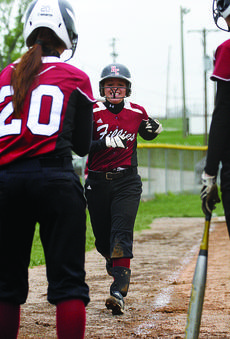 """<div class=""""source"""">courtesy of Donald Richie/Richie's Photography</div><div class=""""image-desc"""">Senior Michelle Carson is congratulated by fellow senior Lorraine Dennie after Carson sent her across the plate on a two-run homer early in the game against Bracken County Tuesday. The Fillies went on to beat the Lady Polar Bears, 5-4.</div><div class=""""buy-pic""""><a href=""""http://web2.lcni5.com/cgi-bin/c2newbuyphoto.cgi?pub=081&orig=web-michelle-carson.jpg"""" target=""""_new"""">Buy this photo</a></div>"""