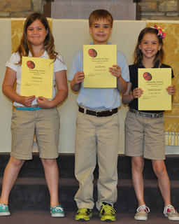Outstanding Achievement in Reading. St. Edward students receiving the Outstanding Achievement in Reading award were: from left, Avery Barnes, A.J. Perraut, Sydney Furnish.