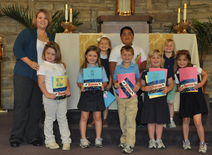 Academic Awards for Kindergarten. Front row, from left, Kim True-Teacher, Grace Scrudder-Artistically and Most Enthusiastic Awards, Caitlin Taylor-Kindness and Most Helpful Awards, Calvin Heimlich-Friendliest, Math, Classroom Citizenship and Good Work Ethic Awards, Abigail Rion- Responsible/Dependable, Artistically, Good Work Ethic and Good Penmanship Awards, Skylar Hatfield-Classroom Neatness, Most Teacher Like Award, Outstanding Achievement in Reading and Good Work Ethic Awards; back row, Audrey Dawson-Agenda Book Organization and Most Enthusiastic Awards, Ryan Cabrera-Significant Academic Improvement, Math, Politeness and Outstanding Achievement in Reading Awards, Savannah Graham-Most Improved, Most Creative Thinker, Positive Attitude and Good Work Ethic Awards.