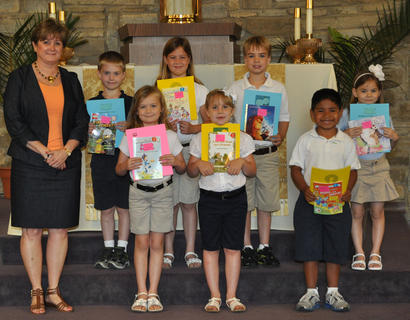 Academic Awards for First Grade. Front row, from left, Debbie Henson-Teacher, Olivia Barry-Most Creative Thinker Award, Karley Furnish-Friendly/Helpful Award, Rylee Spence-Significant Academic Improvement and Classroom Citizenship Awards; back row, Jacob Hargett-Good Work Ethic Award, Avery Barnes-Most Improved Award, A.J. Perraut-Positive Attitude Award.