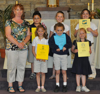 Academic Awards for Second Grade. Front row, from left, Debbie McKinley-Teacher, Sydney Furnish-Most Helpful Award, Jacob LaFleur-Most Creative Thinker Award, Rachel Rion-Most Improved Award; back row, Samuel Finch-Plato Award for Deep Thinker and Classroom Citizenship Award, Seaanna Skinner-Artistically and Significant Academic Improvement Awards, and Courtney Collins-Responsible/Dependable Award.