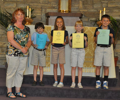 Academic Awards for 3rd grade. Front row, from left, Debbie McKinley-Teacher, Nicholas Barry-Most Creative Thinker Award, Victoria Gasser-Significant Academic Improvement, Good Work Ethic and Most Helpful Awards, Morgan Cooper-Most Improved Award, Ian Boland-Most Enthusiastic Award.