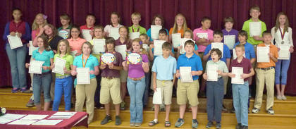 HCMS 6th grade Maroon Team students recognized for their GPA were: back row, from left, Kaylee Clements, Briana Searp, Morgan Hollar, Eli Dahmer, Brittany Worrell, Devin Miracle, Kaylee Hernandez, Sophia Hatterick, Quenton Turley, Zach Navarre, Tyler Linville, Christina Wilson; middle row, Kaitlyn Kiskaden, Hannah Perkins, Jacob King, Kinlee Kellione, Nathan Maynard, Mackenzie Mosig, Gage Bailey, Trenton Henderson, Duncan Wiley; front row, Lauren Bentley, Kenzie Jones, Mackenzie Moore, Boston Pergram, Victoria Iseman, Chance Kemplin, Dawson Miller, Mitchell Pergram, Marvin Debruler.