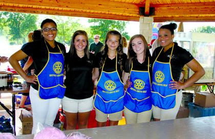 (Left to Right) Harrison County High School Cheerleaders Kiah Moss, Hannah Craig, Sara Ann Ledford, Autumn Stanfield and Kimie Moss volunteered to work at the Fabulous Fourth concession stand.