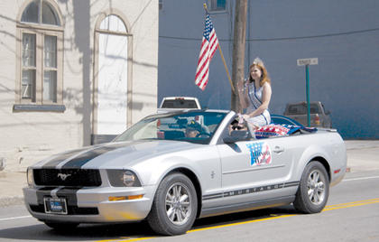 2013 Miss Harrison County Allison Wade waved to the crowd at the Pride in Our Community Parade.