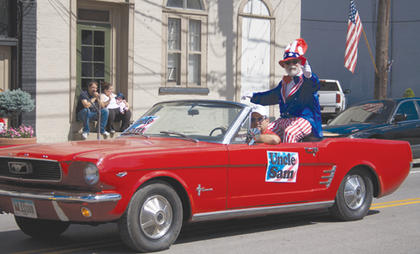 Uncle Sam waved and pointed at the crowd on Main Street along the Pride in Our Community Parade route.