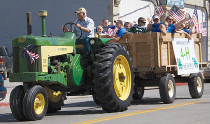 A tractor pulled members of the Harrison County 4-H Club along the parade route as they waved and cheered to the crowd.
