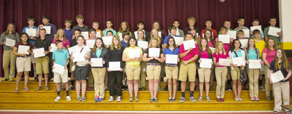 Seventh grade Maroon Honor Roll students recognized were: front row, from left, Duncan Wiley, Kristen Shepherd, Gracie Richardson, Emma Ray, Hannah Perkins, Gracie Murphy, Jordan Jenkins, Quenton Turley, MacKenzie Mosig, Danielle Kinney, Lauren Hitch, Sierra Eckler, Maryanna Denkins, Sarah Myers; second row, Jessica Torres, Gannon Terhune, Michael Ann Stephens, Thomas Morris, Dawson Miller, Chance Kemplin, Makinlee Kellione, Madison Kellione, Robie Mullins, Sophia Hatterick, Robin Harrison-Roberts, Andrew Day, Braxton Bramel, Trevour Barker; back row, Brittney Worrell, Thomas Thompson, Isaac Sims, Chris O'Neal, Tyler Linville, Rocky Kearns, Cody Howard, Morgan Hollar, Sean Hill, Jima Hill, Clay Furnish, Daniel Faulkner, Eli Dahmer, Sheldon Baxter, Kyle Barnes, Josh Baber, Nigel Amick.