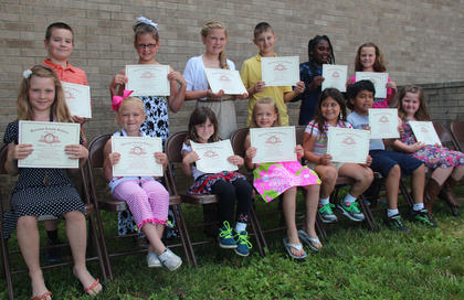 Students receiving Perfect Attendance awards were: Maggie Davis, Emma Hamm, B.J. May, Lesley May, Shelby Oaks, Andrew Harpe, Emilee Preece; back row, Colin Perkins, Lily Winkle, Jaelyn Terhune, Cameron Harrison, Kirsten Griggs, Gracie Davis.