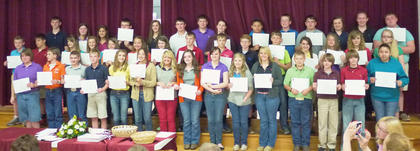 HCMS students receiving awards for having all A's and B's this academic year were: front row, from left, Shellie Woolums, Austin Snapp, Quentin Sowder, Michael Mattox, Natalie Kinney, Katie Stein, Amy Johnson, Brooklyn Jackson, Stefanie Harney, Carolina Elliot, Havanna Gollihue, Tristan Ellington, Isaiah Brueggen, Jacob Brueggen, Anjelica Hernandez; second row, Kyler Williams, Tanner Wells, Madison Wells, Chandlyr Puckett, Sara Ann Ledford, Alexis Lanza, Ruthie Sparkman, Josh Hall, Drew Furnish, Matthew Fugate, Ben Bradford, Lexi Anderson, McKayla Cloyd, Sarah Doyle, Shayanna King; third row, Will Marsh, Alex Tumey, Jessi Petty, Aaron Howard, Larah Kate Kendall, Jake Jones, Russ Faulconer, Autumn Cole, Kacia Clements, Peyton Browning, Joe Banfield, Courtney Gaunce, Emma Darnell, Austin Hill.