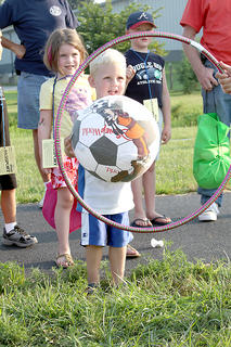 Harrison Memorial Hospital sponsored and held their Longest Day of Play event Aug. 2, at Flat Run Veterans Park. 131 kids came to enjoy the fun which had 19 different booths to explore and enjoy. Pictured at left is Camden Bowlin and Maggie Lawrence as they try to get the ball through the hoop.