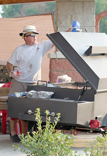 Magistrate and Rotary member Frank Henson grilled hotdogs and hamburgers during the Rotary's Fabulous Fourth Celebration.