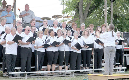 The Licking Valley Singers, under the direction of Karen Bear, performed the National Anthem and two other pieces for the crowd.