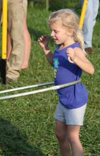 Haylee Briscoe, 5, won the hoola-hoop competition in her age group Friday at the fair's family fun night.
