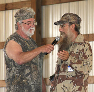 "Emcee Don Wynn interviews ""Si"" portrayed by Eddie Clements at the Ducky Dynasty look-alike contest."
