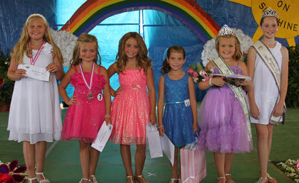Winners in the Miss Junior Pre-Teen competition were: from left, first runner-up Mallory Creech, second runner-up Gabby Florence, prettiest smile Haley Hayes, best dressed Ashlynn McNees, 2013 Miss Junior Pre-Teen Alexis Wright, and 2012 Miss Junior Pre-Teen Anna Midden.