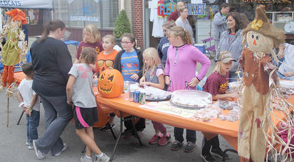 A local girls' softball team had a booth up and running, generating funds for their team.