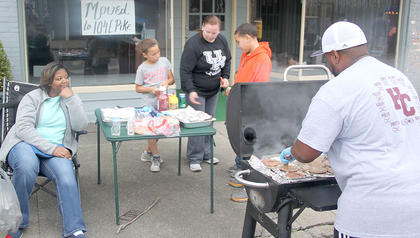 Sherese Doram was intent on making sure that Joe Hinton cooked those burgers just right.