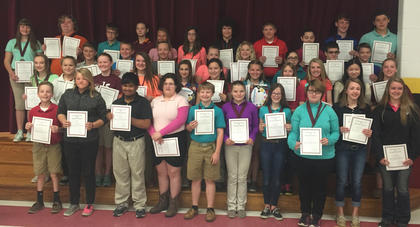 Award Winners. Seventh grade Award Winners were: back row, from left, Kaylee Northcutt, Jason Gant, Aaron Pickett, Ravyn Price, Skylar Hughes, Raven Sullivan, Patrick Marshall, Andrew Nickerson, Amelia McDaniel, Benjamin Lemmings, Benji Brewer; third row, Trent Fry, Nick Royalty, Kendra Fizette, Rileigh Funkhouser, Jaelyn Terhune, Madalynn Jones, Alexander Hein, Ryan Lawrence; second row, Bailey Thompson, Laurel McDaniel, Morgynne Lunsford, Elizabeth Allison, Anna Garrison, Emma Tackett, Molly Perkins, Haley Fryman, Kendall Box, Sarah McLoney, Brooklynn McFarland; front row, Alec Davisson, Tiffani Hill, Alan Roque, Shania Pack, Caden Maners, Jensen Sullivan, Amber Kern, Elizabeth Uhles, Rachel Clifford, Hailey Herrington.