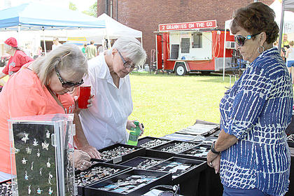 Gail Diamond and Diana Fogle shopped at the jewelry booth of Betty Dedman.