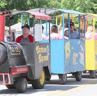 Adults and kids enjoyed train rides from one end of Berry to the other.