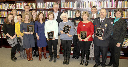 "Recipients of the 45th annual Cynthiana Harrison County Chamber of  Commerce awards are: front row, from left, Jennifer Gossett, Codye McCann, Rebecca McCauley, Cassie Moses, Mandy Gossett-Tornton, Kathy Foster, Elizabeth ""Jimmie"" Herrington, Judy Ankeny Phillips, Chief Jay Sanders, Pat Grenier, Chamber executive director; back row, Colleen Emery, 2015 Chamber president, James Smith, out-going president, David Foster, Anglie Kendall and Mike Malone."