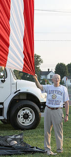 "Bob Owen joined in the singing of ""America"" as he held tight to the flag."