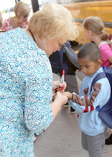Northside principal Sharon Hill met students as they got off the bus for their first day.