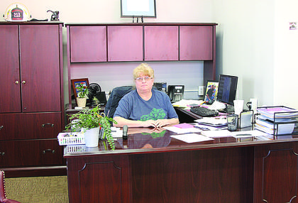 Jamie Hutchison, city clerk, works from her new office at the front of the building.