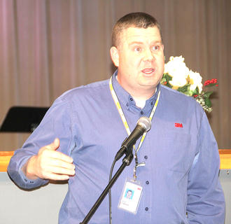 3M plant manager Eric Opland, vice-president of the Chamber of Commerce, spoke to the audience about the Chamber's Ambassador Program.