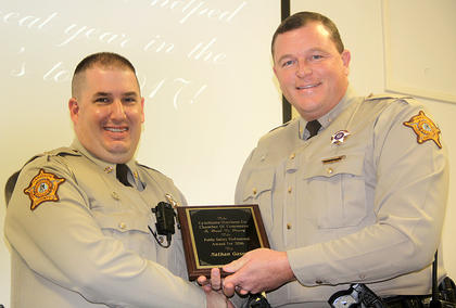 Public Safety Professional of the Year Sheriff Shain Stephens, on the right, presented the 2016 Public Safety Professional of the Year award to Deputy Nathan Gasser.
