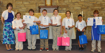 Fifth Grade Diplomas. St. Edward School fifth grade students receiving their diplomas were: from left, Kendra Cooper (teacher), Payton Walker, Eli Hargett, Riley Switzer, Lucy Barry, Maria Furnish, Mynor Spence, Noah Daily.